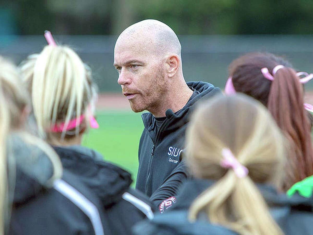 SIUE women's soccer coach Derek Burton gives his team instructions during a game last season at Korte Stadium.