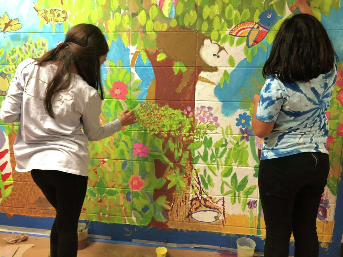 Fifth grade students at Norwalk's Silvermine Elementary School paint the 2020 mural as a gift to the school. This year's theme is Norwalk's Hoyt Island.