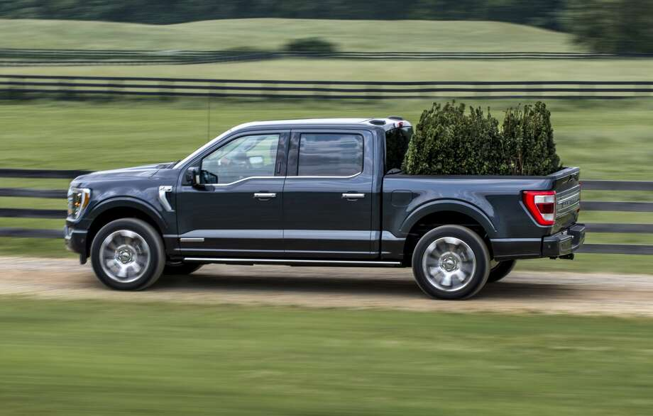 Ford said the 2021 F-150s with the available 3.5-liter PowerBoost hybrid powertrain will have a range of about 700 miles on a tank of gas. Photo: Ford / Ford Motor Co.