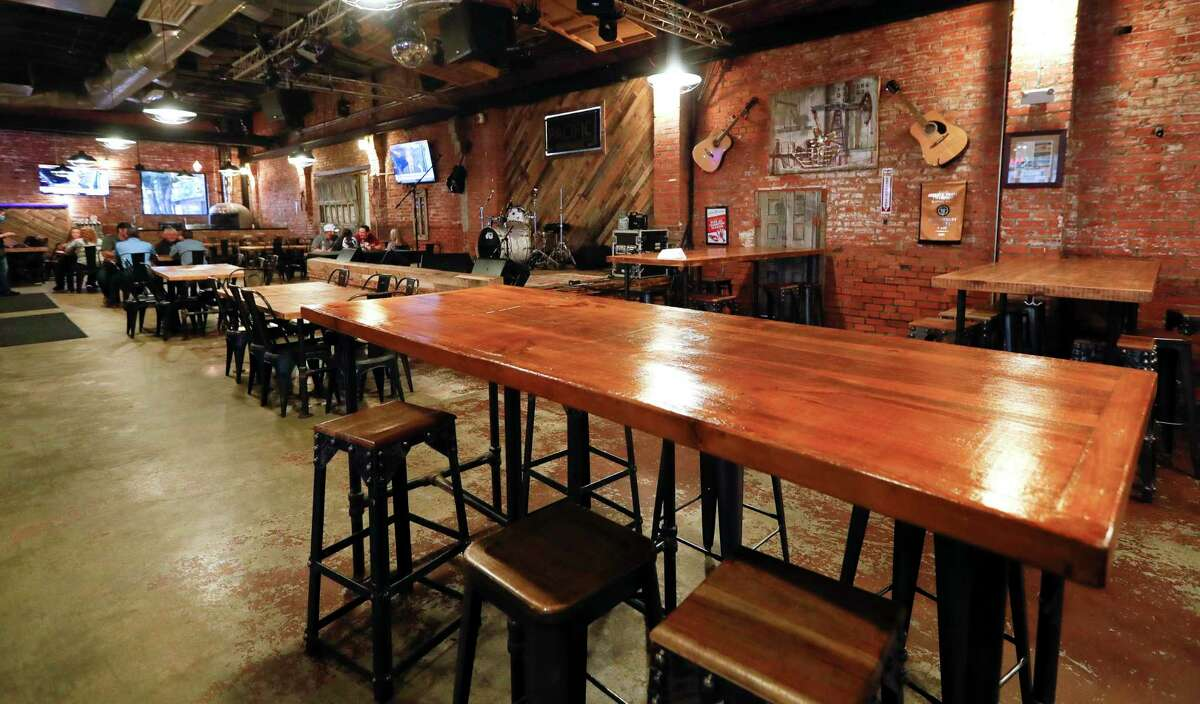 Tables are seen at Pacific Yard House, Friday, June 26, 2020, in Conroe. Gov. Greg Abbott ordered restaurants to return to 50% capacity as of Monday along with other measures to stem the rise of coronavirus infections ahead of the Fourth of July holiday.