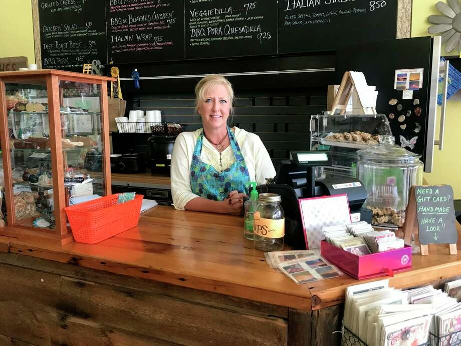Kelly Dennis, owner of the Yellow Window and Little Brown Sack Deli, said she loves working with the people in the Big Rapids community and getting to know other business owners in the downtown area. (Pioneer photo/Taylor Fussman)