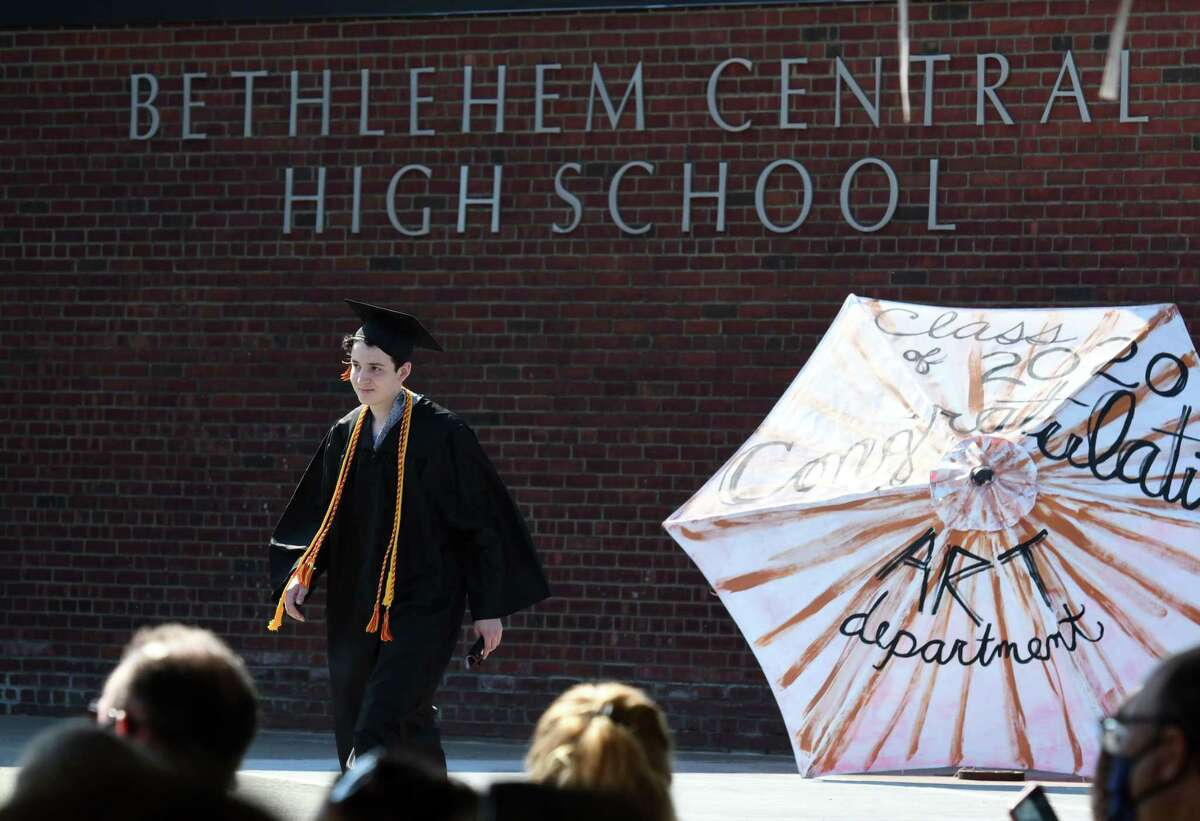 Graduating Bethlehem High School senior Daniel Ledezma walks to the stage during commencement exercises on Friday, June 26, 2020, in Bethlehem, N.Y. Three-hundred and ninety-six students were awarded diplomas this year, according to the district website. (Will Waldron/Times Union)