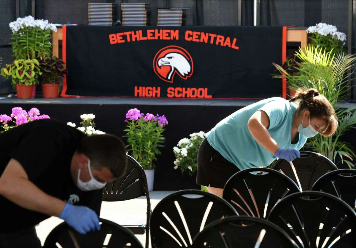 Chairs are disinfected following a Bethlehem High School graduation group ceremony on Friday, June 26, 2020, in Bethlehem, N.Y. Commencement exercises were done in small groups to keep with coronavirus safety measures. (Will Waldron/Times Union)