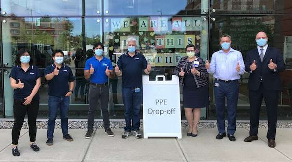 ASML employees bring donations of personal protective equipment to Stamford Hospital on June 25. From left, Rui Chang (ASML Group Leader - Wilton System Integration), Phil Choi (ASML Group Leader - Reliability), Thomas Liaskas (ASML Project Lead), Vic Cappelli (ASML Director of Integration, Quality and Reliability Engineering), Liz Longmore, Vice President, Ambulatory Services and Chief Operating Officer, Stamford Health Medical Group; Chris Riendeau, Senior Vice President, Fund Development, Brendan Schepis, Executive Director, Supply Chain.