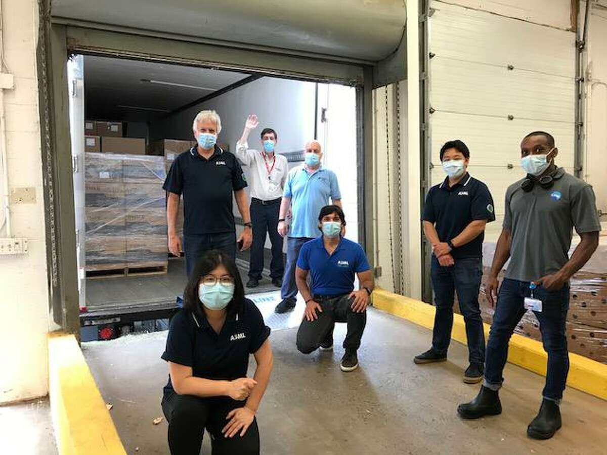ASML employees bring donations of personal protective equipment to Nuvance Health on June 25. From left: Rui Chang (Group Leader - Wilton System Integration), Vic Cappelli (Director of Integration, Quality and Reliability Engineering), Bill Poulos (Nuvance Supply Chain Manager), Ralph DiMeglio (Nuvance Supply Chain), Thomas Liaskas (Project Lead), Phil Choi (Group Leader - Reliability), Vladimir Guillaume (ASML Shipping).