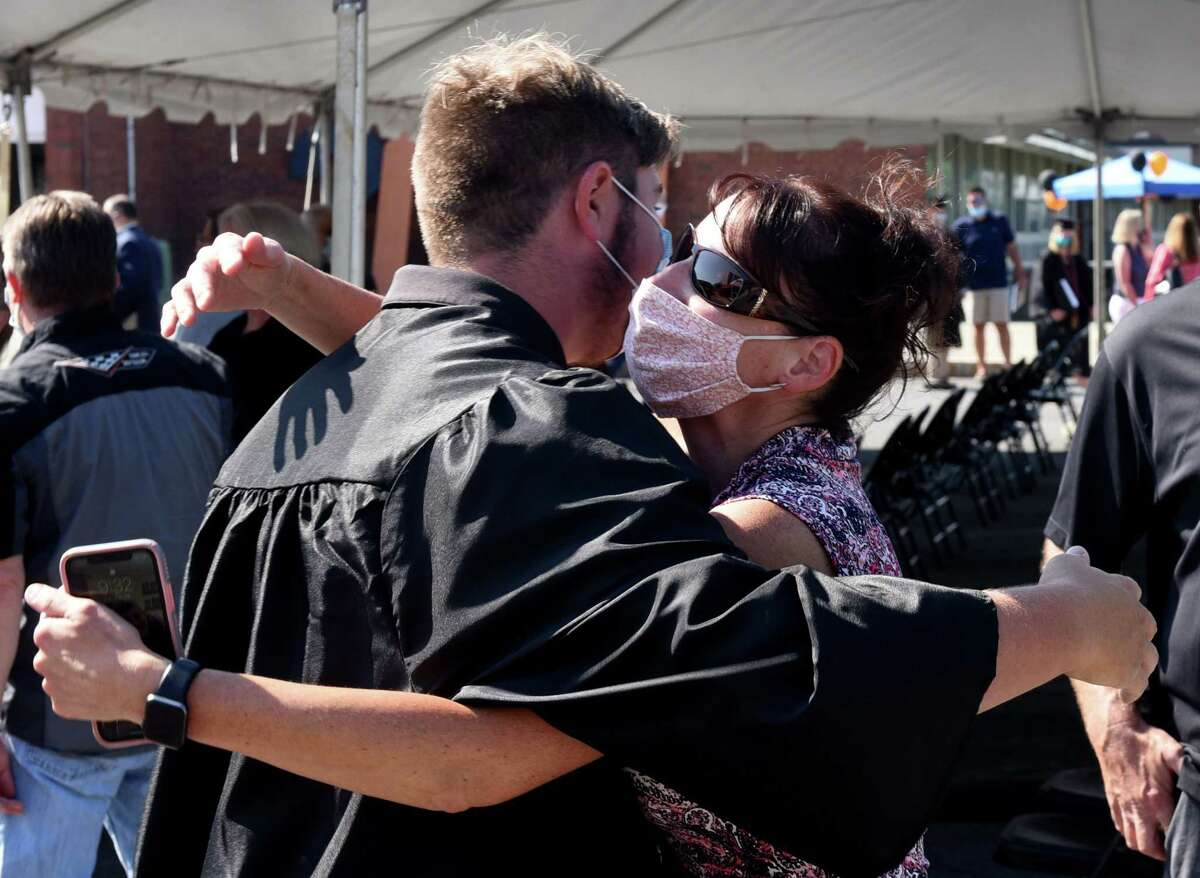 Graduating Bethlehem High School senior Garrett Skultety is embraced by his mother, Laurel, following commencement exercises on Friday, June 26, 2020, in Bethlehem, N.Y. Three-hundred and ninety-six students were awarded diplomas, according to the district website. (Will Waldron/Times Union)