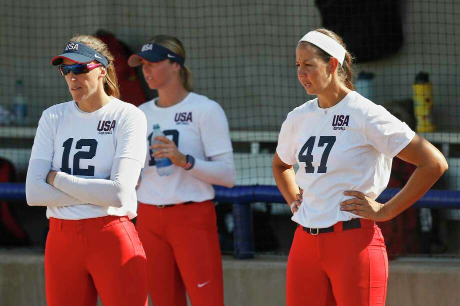 Former Scrap Yard Dawgs softball players, including pitchers Monica Abbott, left, and Cat Osterman, have developed a new identity for their independent team. Photo: Sue Ogrocki, STF / Associated Press / Copyright 2019 The Associated Press. All rights reserved.