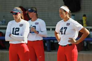Former Scrap Yard Dawgs softball players, including pitchers Monica Abbott, left, and Cat Osterman, have developed a new identity for their independent team.