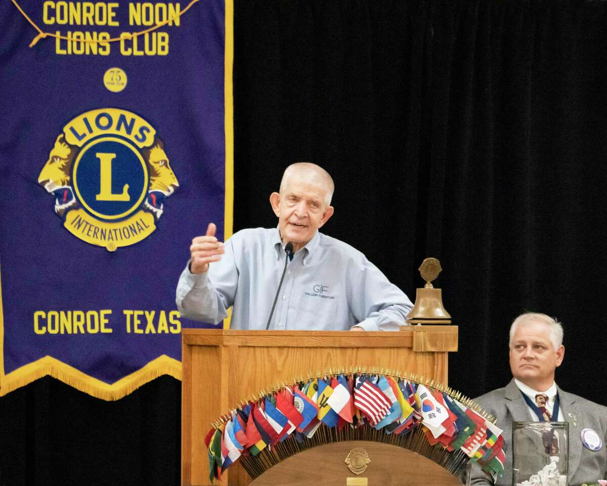 Conroe Noon Lions Club President Scott Perry listens as Houston's own Mattress Mack, Jim McIngvale, speaks at the club's annual Community Partners Appreciation Luncheon last Wednesday.