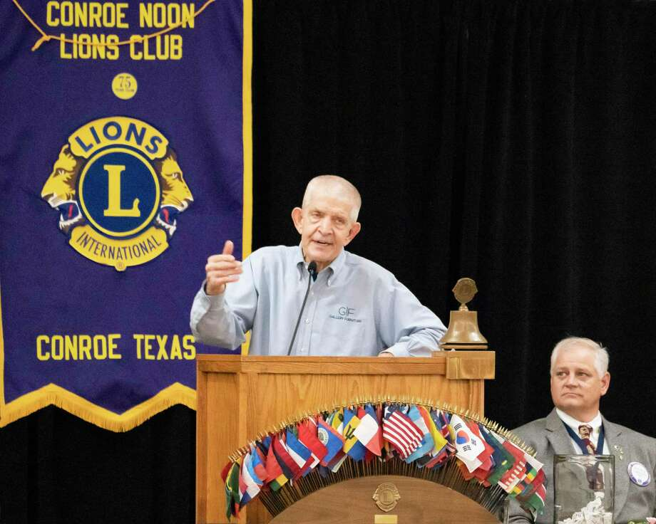 Conroe Noon Lions Club President Scott Perry listens as Houston's own Mattress Mack, Jim McIngvale, speaks at the club's annual Community Partners Appreciation Luncheon last Wednesday. Photo: Courtesy Photo / constance mcnabb dvm