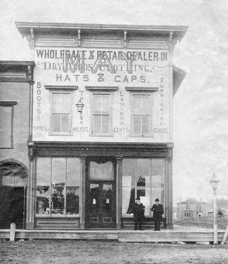Jacob May general store, Frankfort, corner of 6th and Main, in 1870's, with Charles Voorheis on left and A.G. Butler on right. (Courtesy Photo)