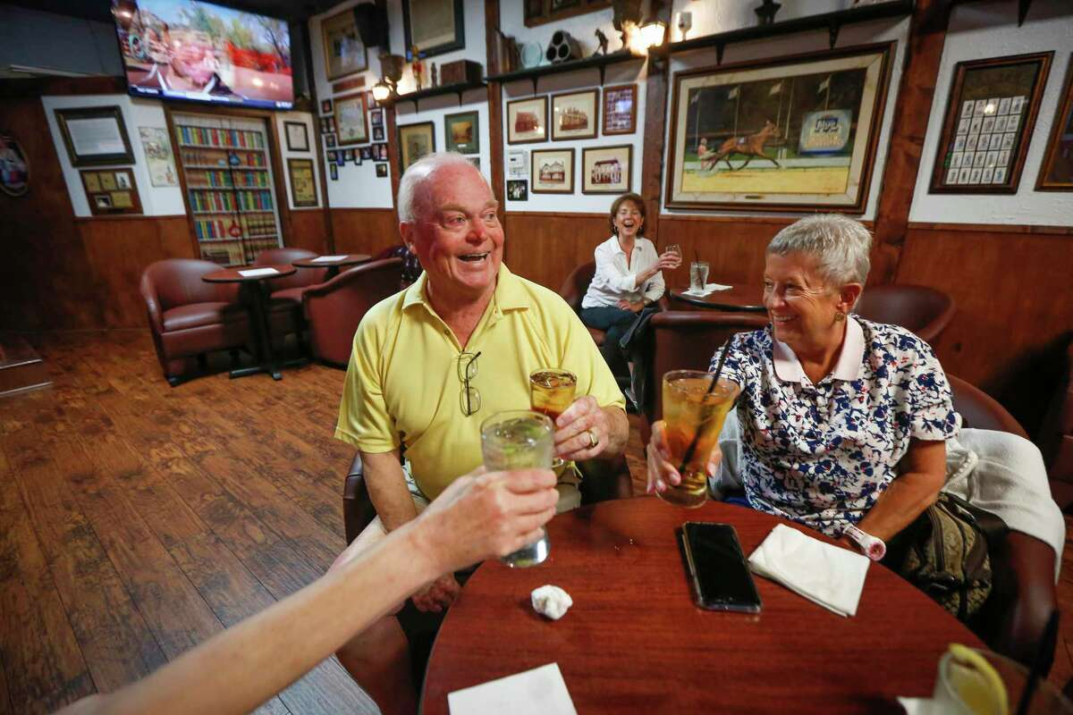 At noon, Mike and Stephanie Smith enjoyed a last toast in Ron's Pub as Gov. Greg Abbott's order to shut down all bars in Texas became in to effect Friday, June 26, 2020, in Houston.