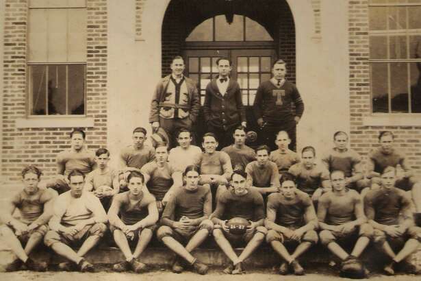 Members of the Conroe High School football team in the 1926-27 school year in front of Crockett High School.