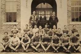 Members of the Conroe High School football team in the 1926-27 school year in front of Crockett High School.