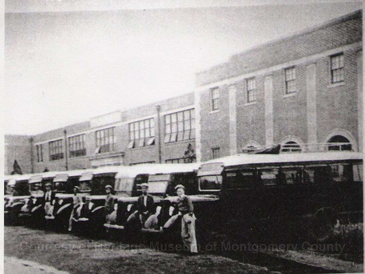 Conroe ISD buses and bus drivers lined up in front of Crockett High School during the 1926-27 school year.