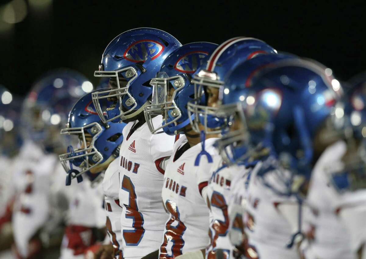 West Brook Bruins stand for the National Anthem before playing against Strake Jesuit Crusaders in a high school playoff football game on November 22, 2019 at Challenger Stadium in Waller, TX.