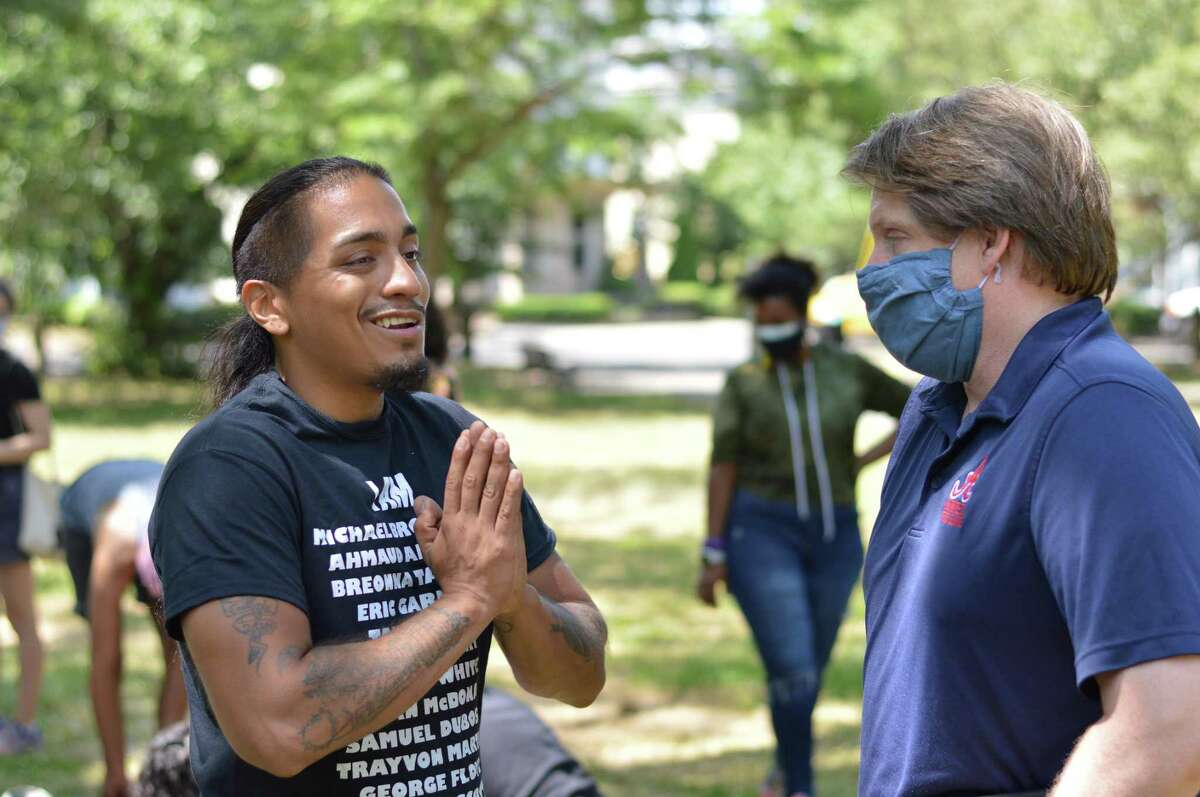 A group of people gathered in Wooster Square Park where the statue of Christopher Columbus was recently removed to advocate for renaming the park after Black developer William Lanson.