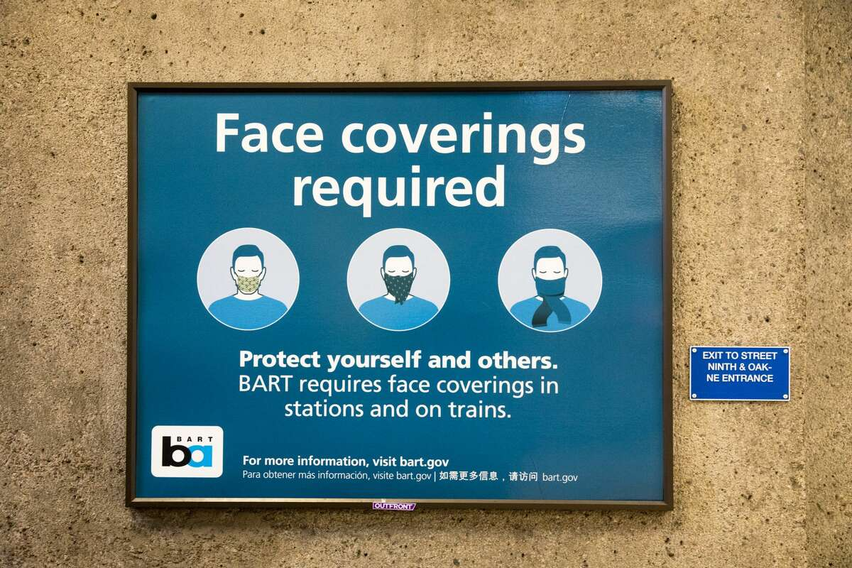 A sign instructs BART riders to wear masks at the Lake Merritt station in Oakland, Calif. on June 26, 2020.