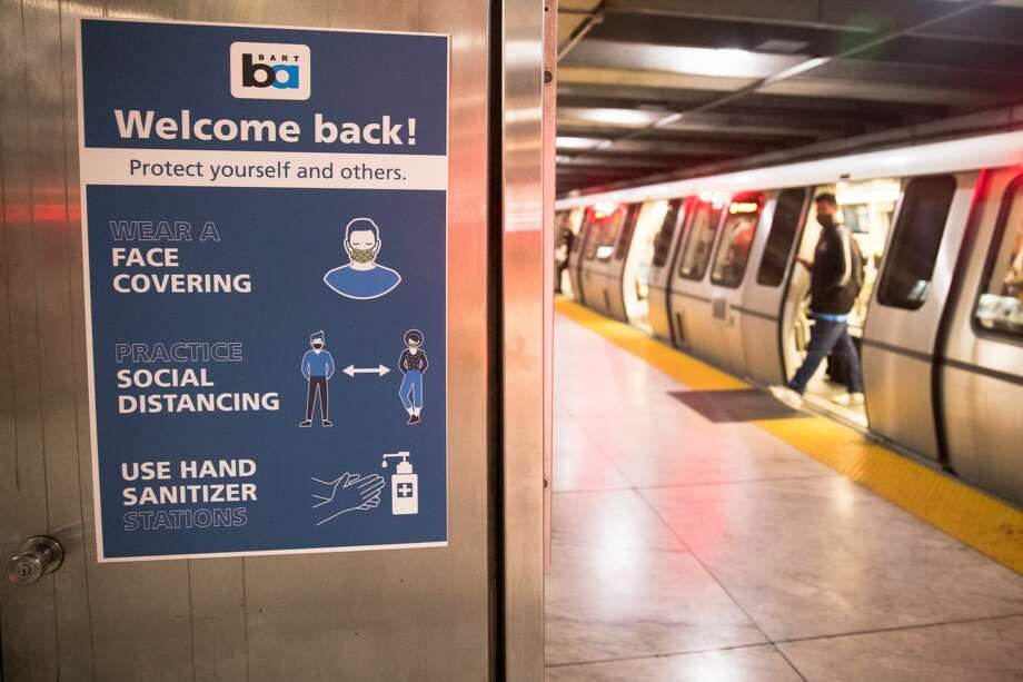 A sign at the Embarcadero station reminds people of health restrictions in San Francisco, Calif. on June 26, 2020. BART has placed signs reminding riders to wear make and social distance through the train system due to the COVID-19 coronavirus. Photo: Douglas Zimmerman/SFGATE / SFGATE