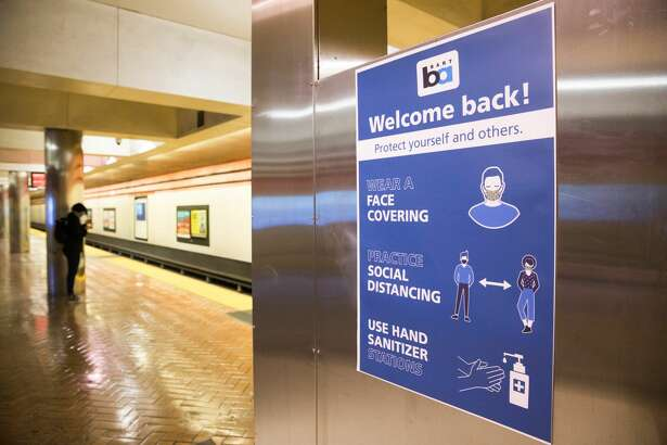 A sign at the Powell BART station reminds people of health restrictions in San Francisco, Calif. on June 26, 2020. BART has placed signs reminding riders to wear make and social distance through the train system due to the COVID-19 coronavirus.