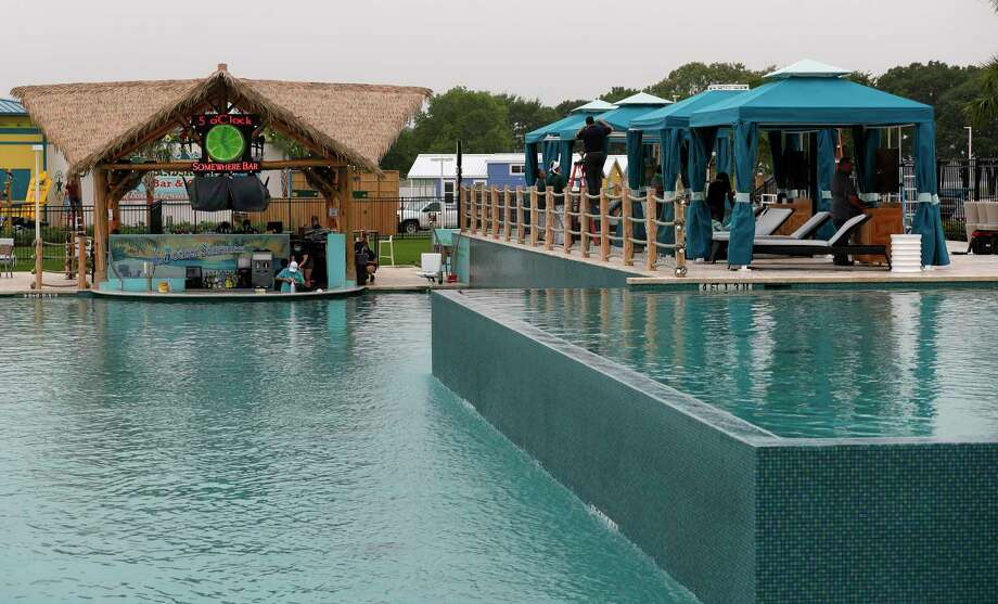 The pool and lounge area of the '5 O'Clock Somewhere' swim-up pool bar is seen during the grand opening of the Margaritaville Resort, Friday, June 26, 2020, in Montgomery. The highly anticipated 186-acre resort features a splash of dining concepts and recreational activities, including a water park, an 18-hole golf course and boat rentals. In addition to a 72,000 square foot conference and event space, there are 303 suites in the 20-story luxury tower and another 32 lake cottages on the property. Photo: Jason Fochtman, Houston Chronicle / Staff Photographer / 2020 © Houston Chronicle