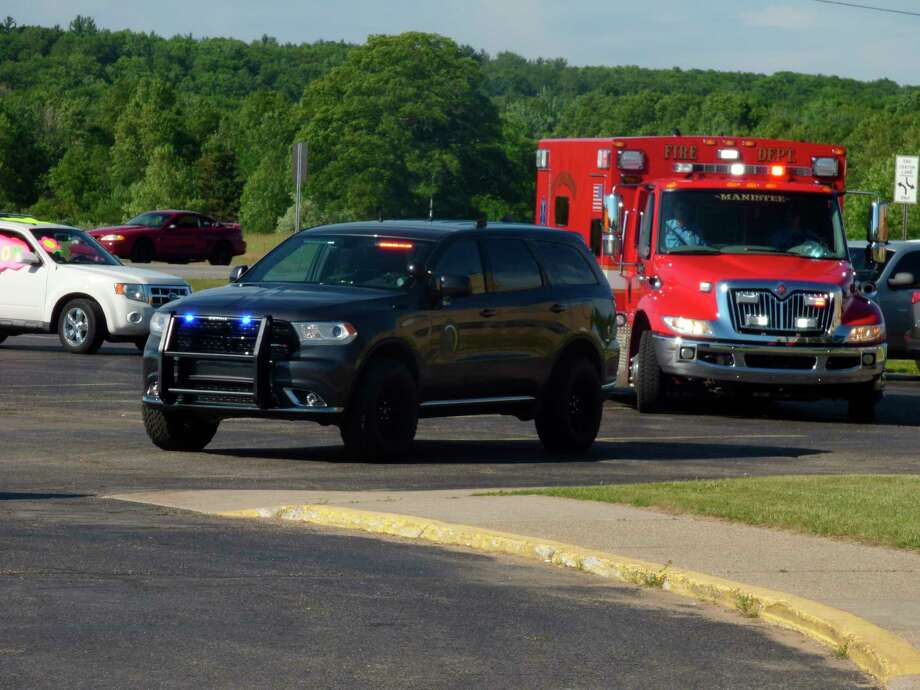 First responders joined in the Honks for Hugs paradeJune 25 at the Manistee County Medical Care Facility. (Scott Fraley/News Advocate)