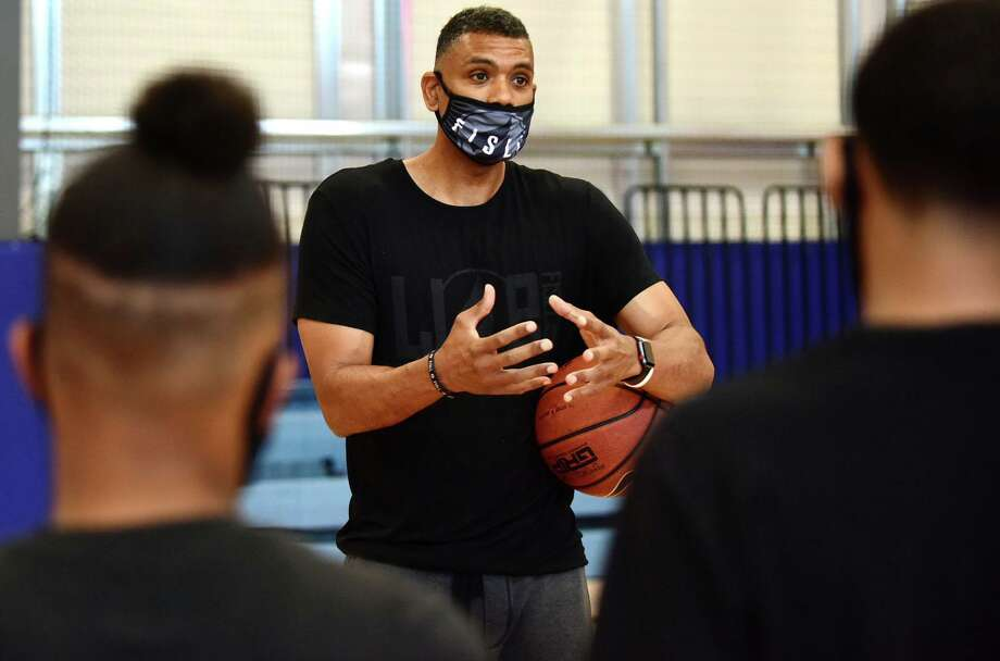 Basketball player Allan Houston, local teens and dignitaries gather at the new Teen Center at the Stamford Boys/Girls Club Friday June 26, 2020, in Stamford, Conn. The Club opens Monday to limited programming. Photo: Erik Trautmann / Hearst Connecticut Media / Norwalk Hour