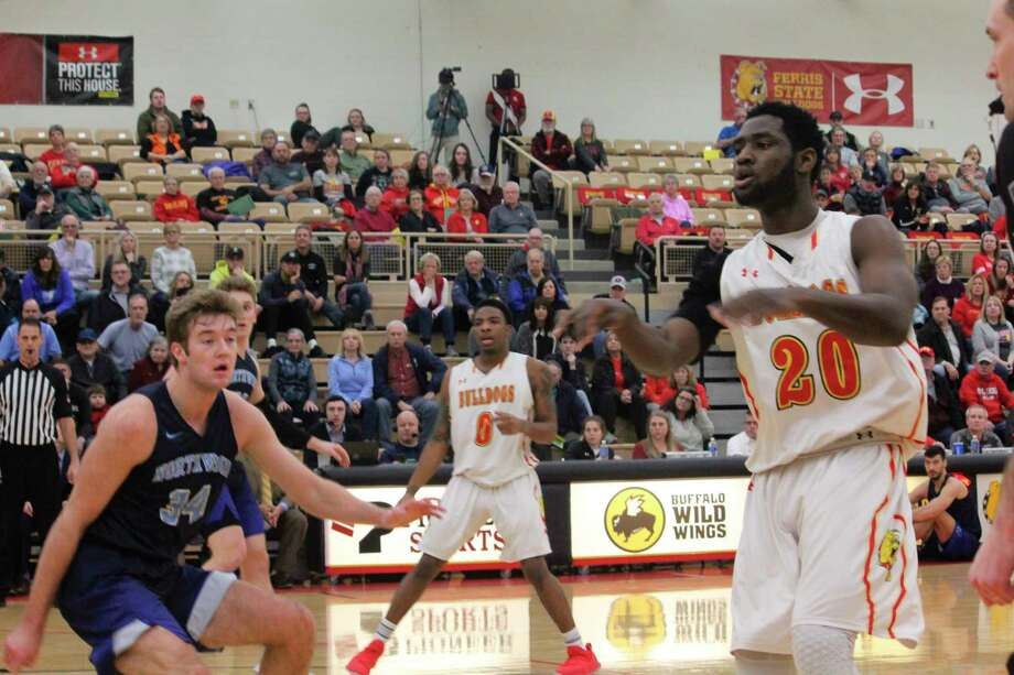 Ferris's Dorian Aluyi (20) looks to make a play during the 2019-20 season. (Pioneer file photo)