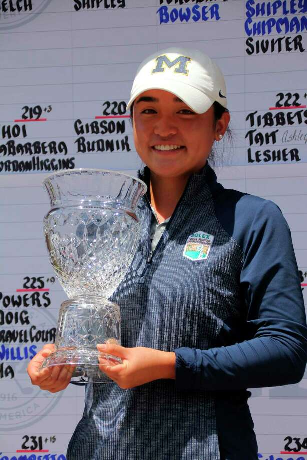 Anika Dy, of Traverse City, holds her trophy after becoming just the second amateur ever to win the Michigan PGA Women's Open Championship last year. Crystal Mountain will be hosting this year's three-day tournament starting Monday on the Mountain Ridge course. (Courtesy photo)