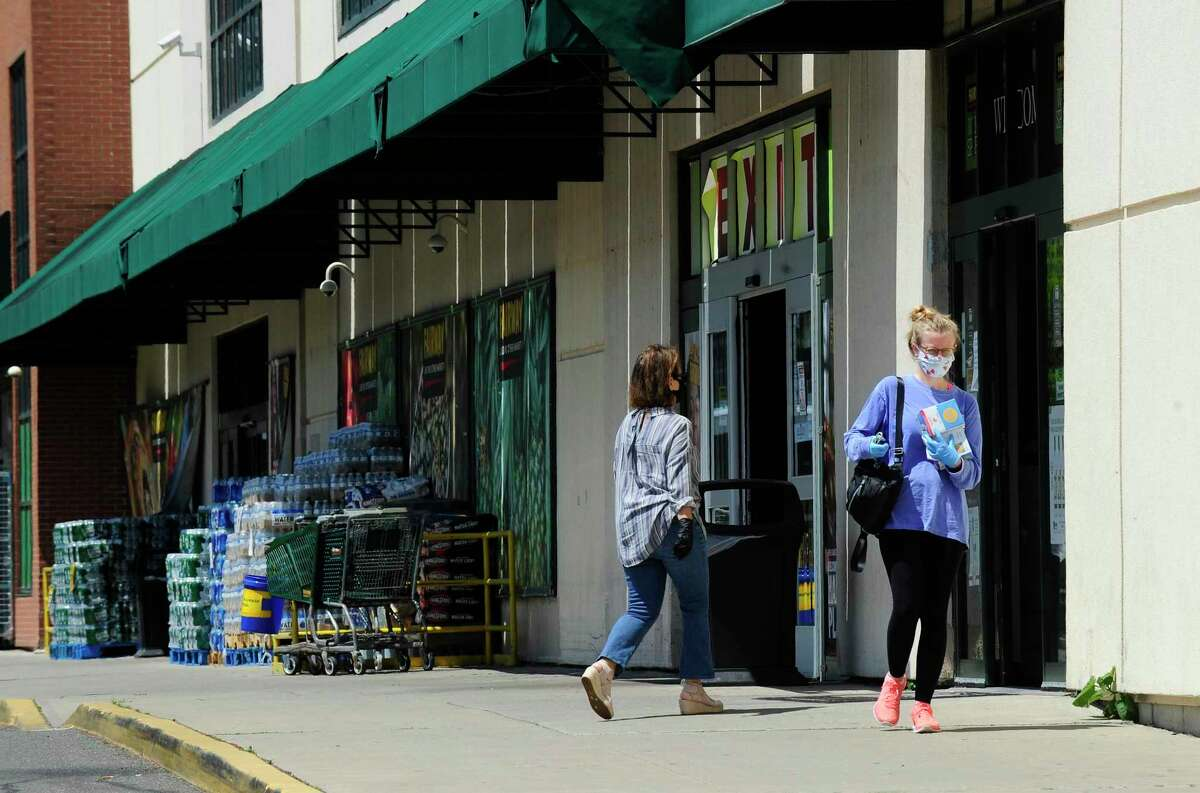 Customers of Fairway Market in Stamford exit with their purchases on May 27, 2020. The Fairway Market and wine-and-spirits store, at 689-699 Canal St., are expected to permanently close between July 3 and July 19, 2020, according to a letter that Fairway has sent to the Connecticut Department of Labor.