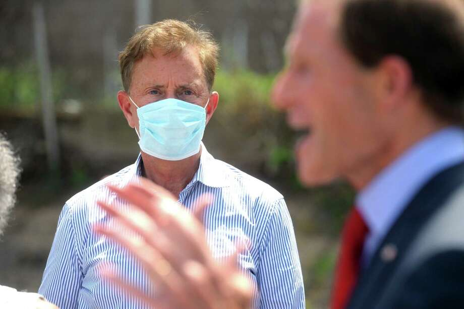 Gov. Ned Lamont looks on as U.S. Sen. Richard Blumenthal speaks during a news conference next to the mobile COVID-19 testing site set up outside Mount Aery Church, in Bridgeport, Conn. June 26, 2020. Photo: Ned Gerard / Hearst Connecticut Media / Connecticut Post
