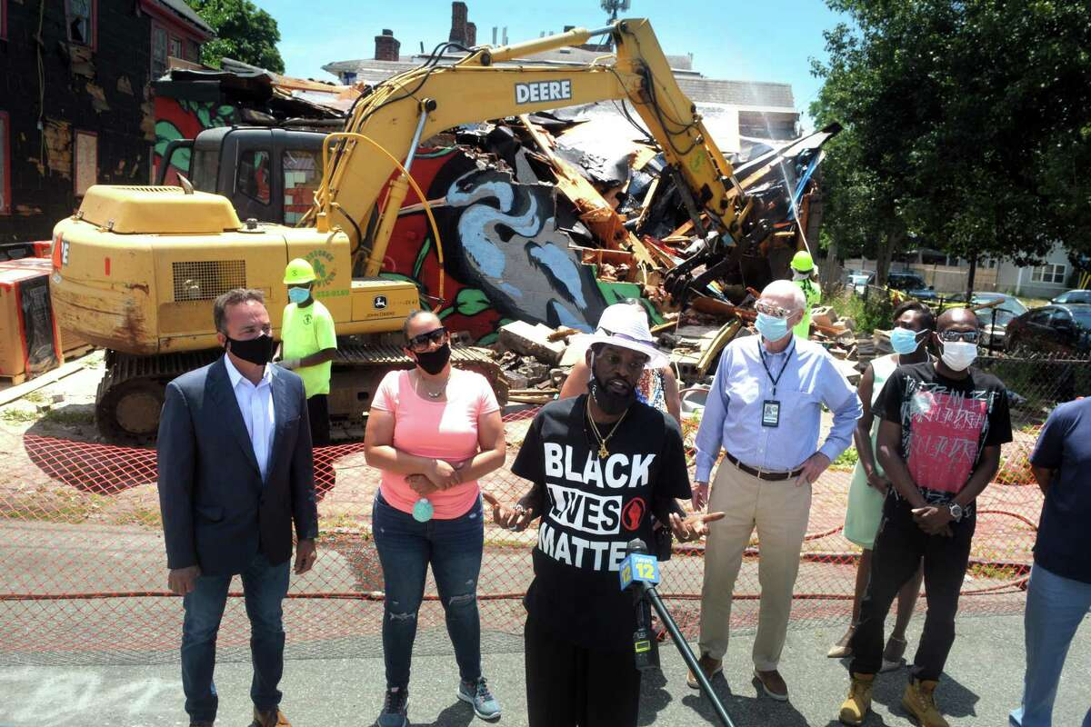 City councilman Ernie Newton speaks at a news conference is the demolition site of a blighted convenience store at the corner of Newfield Ave. and Revere St., in Bridgeport, Conn. June 26, 2020.