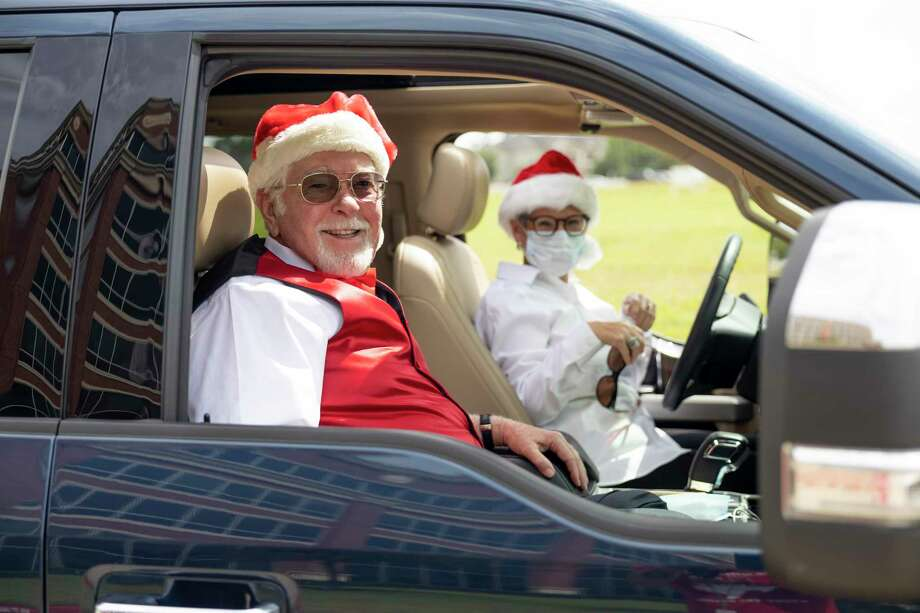 Parade participants pose for a portrait before departing in Spring, Thursday, June 25, 2020. Over 60 vehicles participated in the Christmas car parade which ran for an estimated four miles. Photo: Gustavo Huerta, Houston Chronicle / Staff Photographer / Houston Chronicle © 2020