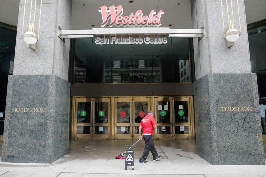 An employee cleans the entrance of the Westfield San Francisco Centre in San Francisco Calif. on June 26,2020. Photo: Douglas Zimmerman/SFGATE / SFGATE