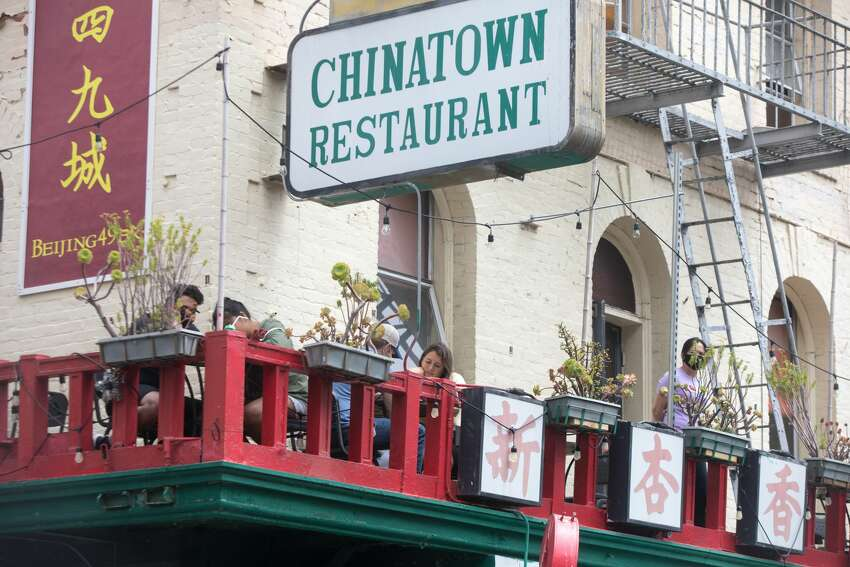 Customers eat on an outdoor porch at Beijing 49 in Chinatown in San Francisco Calif. on June 26,2020.