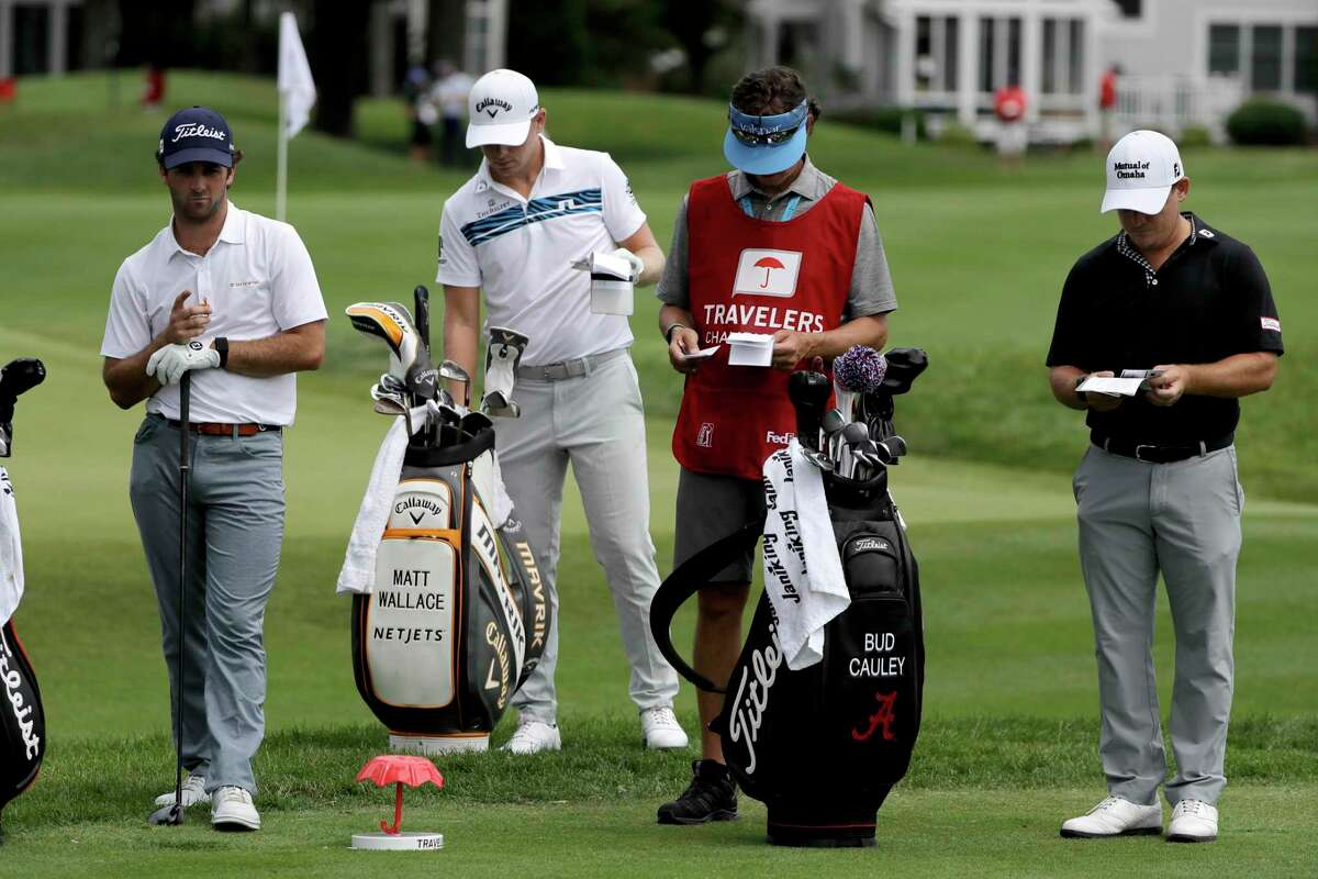 """From left, Denny McCarthy, Matt Wallace, Bud Cauley and Cauley's caddie Matt Hauser stand at the third tee box during Thursday's first round of the Travelers. McCarthy withdrew from the event after testing positive for COVID-19 on Friday, while Cauley followed suit """"out of an abundance of caution."""""""