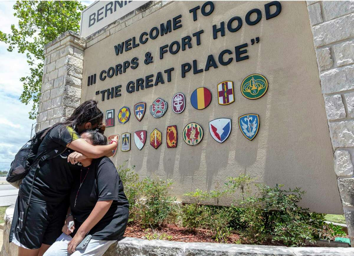 Gloria Guillen, seated, is comforted Tuesday, June 23, 2020 in Killeen by her daughter Lupe Guillen after she spoke at the Fort Hood main gate about her missing daughter, Fort Hood soldier Pfc. Vanessa Guillen.