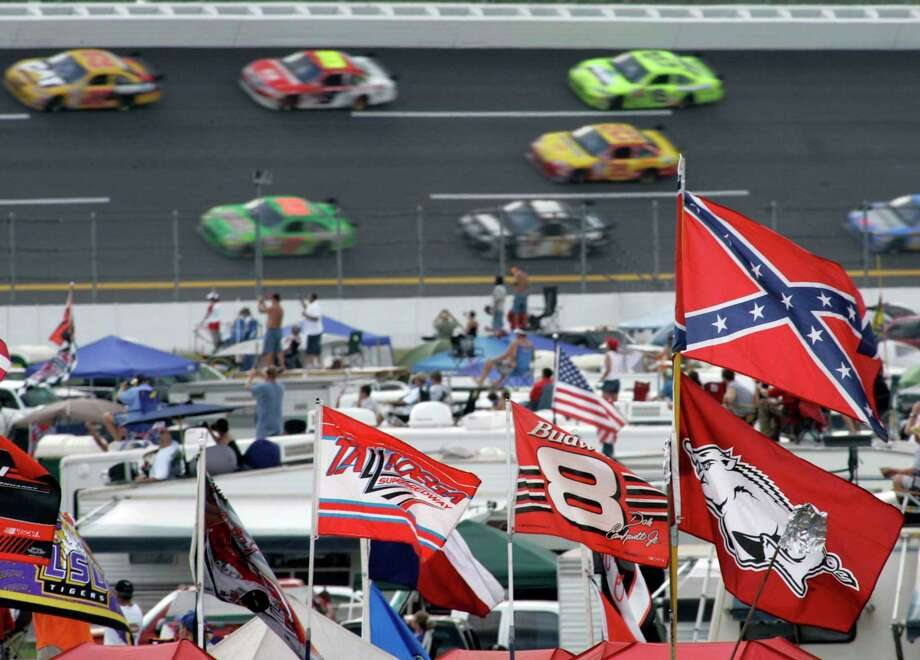 In this 2007 photo, a Confederate flag flies at Talladega Superspeedway in Talladega, Ala. Photo: Rob Carr /Associated Press / Copyright 2020 The Associated Press. All rights reserved.