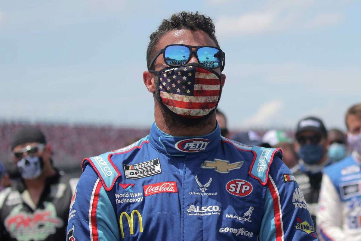 TALLADEGA, ALABAMA - JUNE 22: Bubba Wallace, driver of the #43 Victory Junction Chevrolet, stands on the grid prior to the NASCAR Cup Series GEICO 500 at Talladega Superspeedway on June 22, 2020 in Talladega, Alabama. A noose was found in the garage stall of NASCAR driver Bubba Wallace at Talladega Superspeedway a week after the organization banned the Confederate flag at its facilities. (Photo by Chris Graythen/Getty Images)