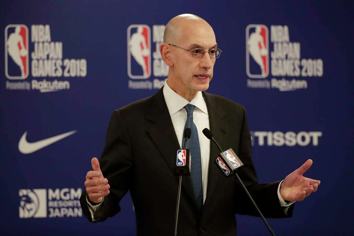 FILE - In this Oct. 8, 2019, file photo, NBA Commissioner Adam Silver speaks at a news conference before an NBA preseason basketball game between the Houston Rockets and the Toronto Raptors in Saitama, near Tokyo. Ita€™s been over three months since the commissioners of major sports cancelled or postponed events because of the coronavirus. Enough time for us to grade them on how theya€™ve handled the virus so far. (AP Photo/Jae C. Hong, File)