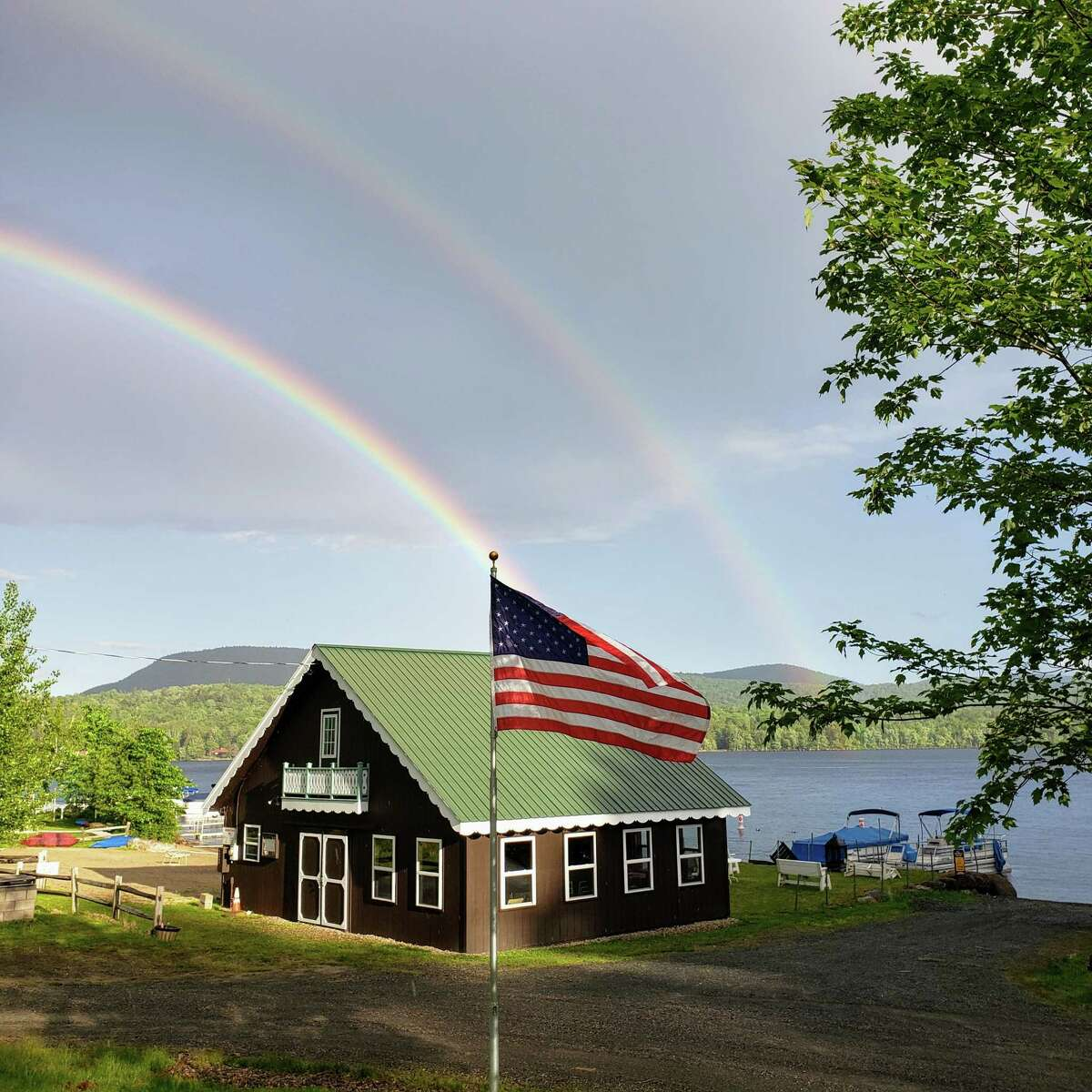 This photo was taken June 6 at Clifton Park resident Patricia Karwatowskia€™s camp at Lake Pleasant park in Speculator. a€œThe building is our community barn and the flag was my dada€™s. The double rainbow after a sprinkle was spectacular!a€