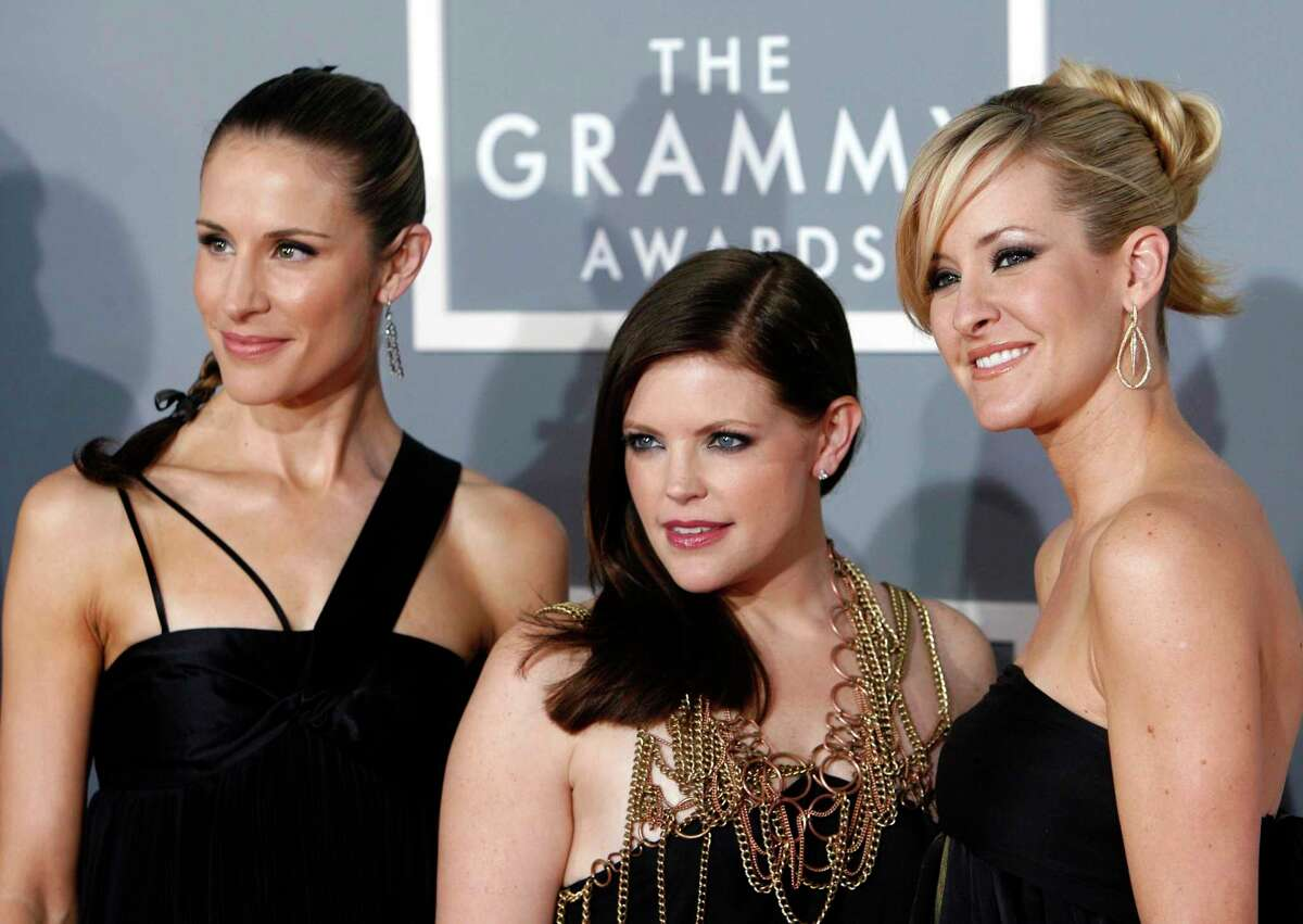 Emily Robison, left, Natalie Maines, center, and Martie Maguire, released a new single this week and debuted their new band name, which dropped the Dixie but kept the Chicks.