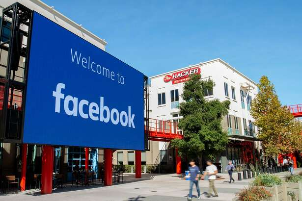 (FILES) In this file photo taken on October 23, 2019 A giant digital sign is seen at Facebook's corporate headquarters campus in Menlo Park, California. - Several US firms have joined a call by activists to halt ad spending on Facebook over concerns the leading social network has fallen short in efforts to crack down on hate speech and incitements to violence. The sporting goods maker Patagonia added its name to the list on June 21, 2020, joining rivals North Face and REI and the freelance staffing agency Upwork. (Photo by Josh Edelson / AFP) (Photo by JOSH EDELSON/AFP via Getty Images)