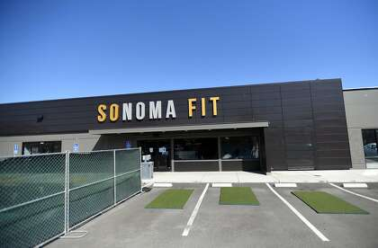A partially blocked off parking lot is designated for outdoor workouts at Sonoma Fitness in Petaluma.