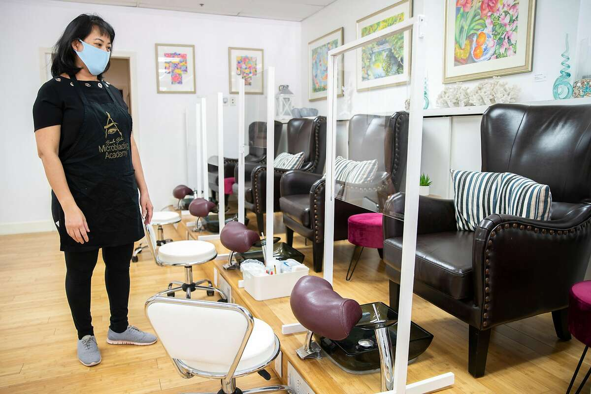 """Yen Tuyet Le at her business Paua Beauty Lounge on Friday, June 26, 2020, in San Francisco, Calif. San Francisco officials said Friday that the city was delaying plans to allow certain businesses """" including nail salons, museums and outdoor bars """" to reopen Monday following a spate of new COVID-19 cases. Cases in California and across the country have spiked in recent weeks, largely following efforts to reopen the economy and allow people to move around more freely."""