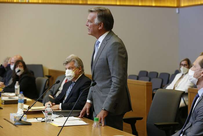 Bill Smith, interim chief executive officer and president of PG&E Corp., makes a closing statement during the criminal sentencing hearing in the trial of Pacific Gas & Electric Corp in Chico, Calif., Thursday, June 18, 2020. Pacific Gas & Electric on Thursday was fined $4 million for the deaths of 84 people killed in a nightmarish Northern California wildfire ignited by the its long-neglected electrical grid. The sentencing comes as the nation's largest utility prepares to end a 17-month bankruptcy proceeding triggered by the catastrophe. (AP Photo/Rich Pedroncelli, Pool)