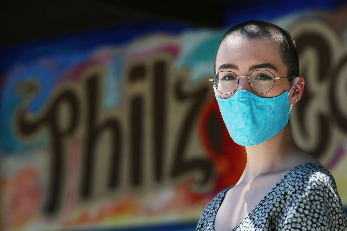Emily Hering, Philz Coffee barista, stands for a portrait in front of Philz Coffee on Monday, June 22, 2020 in Palo Alto, Calif.�Hering does not want to go back to work because of COVID-19 and because she has underlying medical conditions that make her more susceptible.