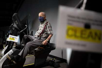 Roger Hillman of Petaluma works out on a stationary bike at Sonoma Fitness in Petaluma.