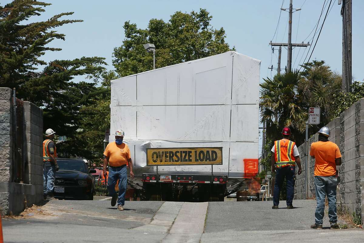 An�Abodu�accessory dwelling units is seen being transported on a truck to a home where it is to be installed on Friday, June 26, 2020 in Millbrae, Calif.