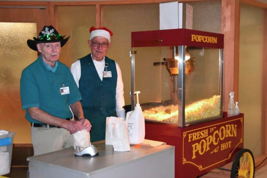 Ted Mudd, chairman, Popcorn Service and volunteer Robert Reid prepare bags of freshly popped popcorn to sell to staff and visitors at MidMichigan Medical Center - Midland. Proceeds from sales are donated to MidMichigan Health Foundation to support projects for patient care. (Photo provided)